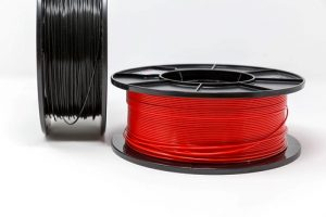 A black and a red spool of filament